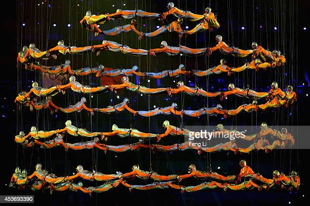 The 300- plus young performers show aerial stunts during the opening ceremony for the Nanjing 2014 Summer Youth Olympic Games at the Nanjing Olympic...
