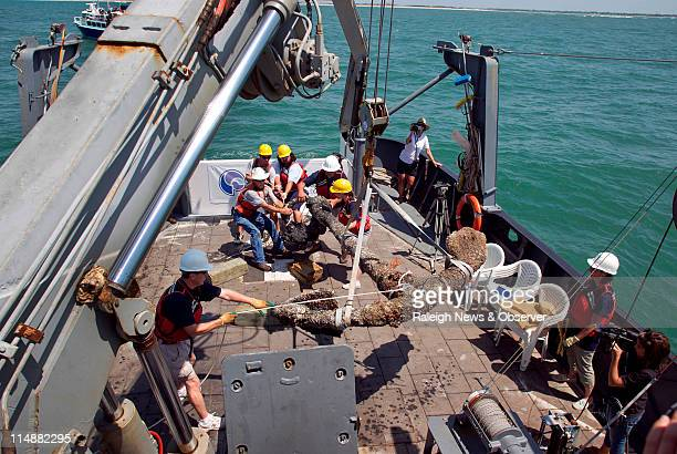 The 3000 pound anchor recovered from the shipwreck of Blackbeard's Queen Anne's Revenge is brought to rest on the deck of the Research Vessel Dan...