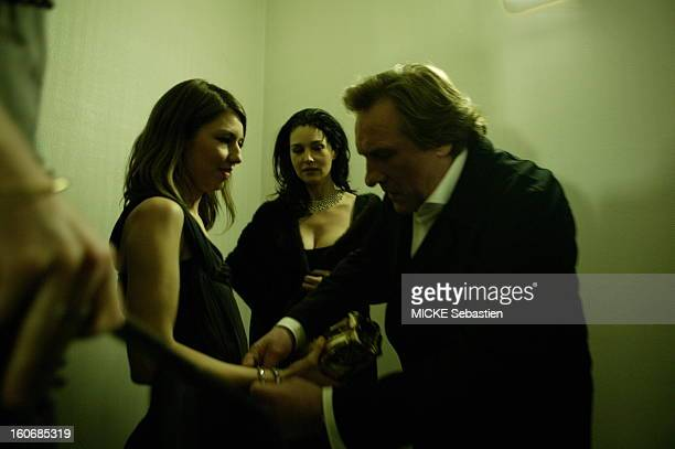 The 30th ceremony of the 2005 CESAR look behind the scenes of the Theatre du Chatelet in PARIS Gerard Depardieu arranging a bracelet on the arm of...