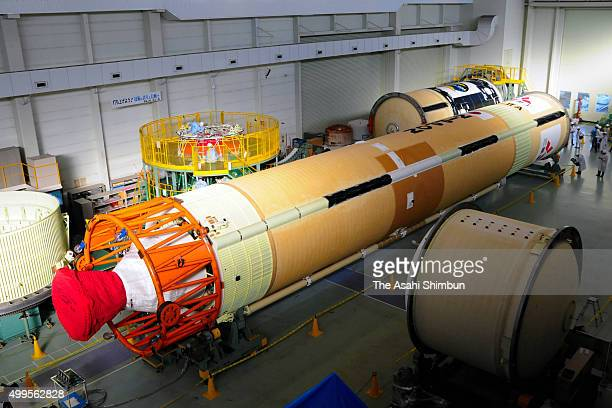 The 31meterlong first stage of H2A Launch Vehicle No 30 is displayed at Mitsubishi Heavy Industries Tobishima Plant on December 1 2015 in Tobishima...