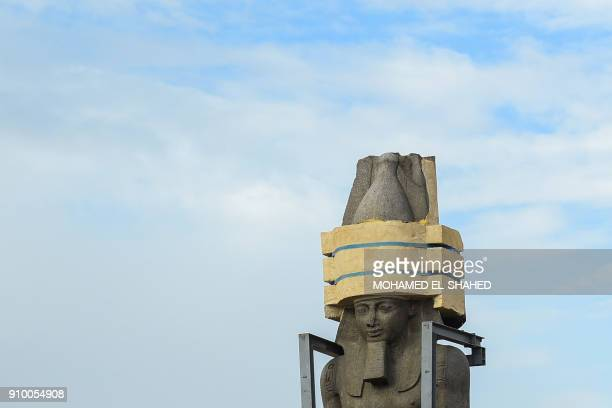 TOPSHOT The 3200yearold colossal statue of King Ramses II is seen during its transfer to the main entrance of the Grand Egyptian Museum in Cairo's...