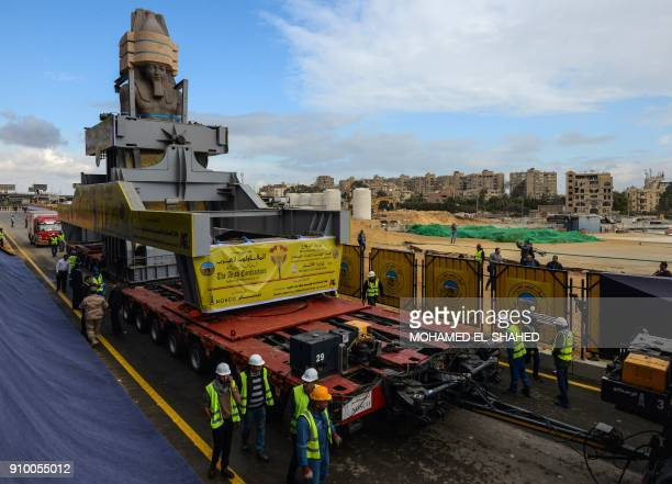 The 3200yearold colossal statue of King Ramses II is seen during its transfer to the main entrance of the Grand Egyptian Museum in Cairo's twin city...