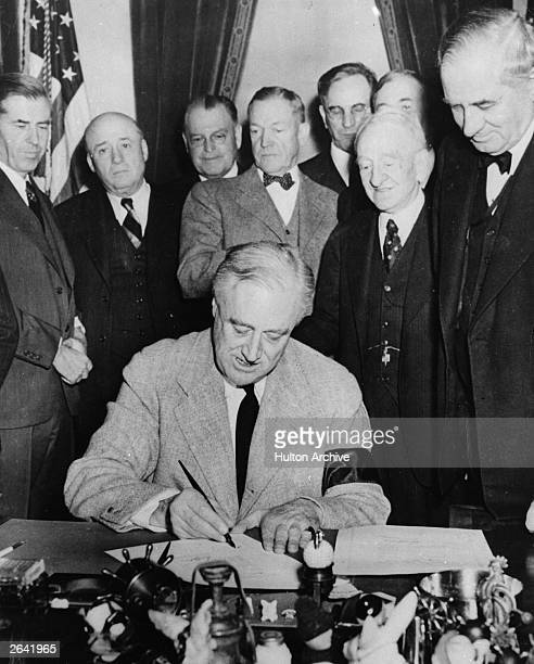 The 32nd American President Franklin Delano Roosevelt signs the declaration of war against Germany and Italy