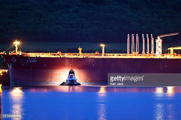 The 333 metre-long C.Spirit, one of the world's largest tankers capable of carrying some two million barrels of oil , berths by night at Hound Point...