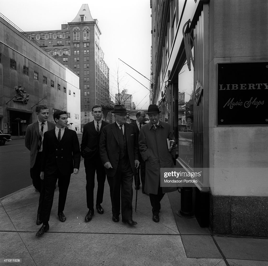 The 33rd President of the United States of America Harry Truman arrives to the edge of a street, where there is a shop sign; collaborators are walking with him. New York (USA), April 1964.