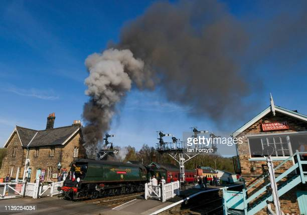 The 34092 City of Wells steam locomotive leaves Grosmont station on March 30 2019 in Grosmont England The Bulleid Light Pacific steam locomotive is...