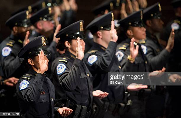The 35 officers of Recruit Officer Class take the oath during the US Capitol Police graduation ceremony in the Capitol Visitor Center auditorium on...