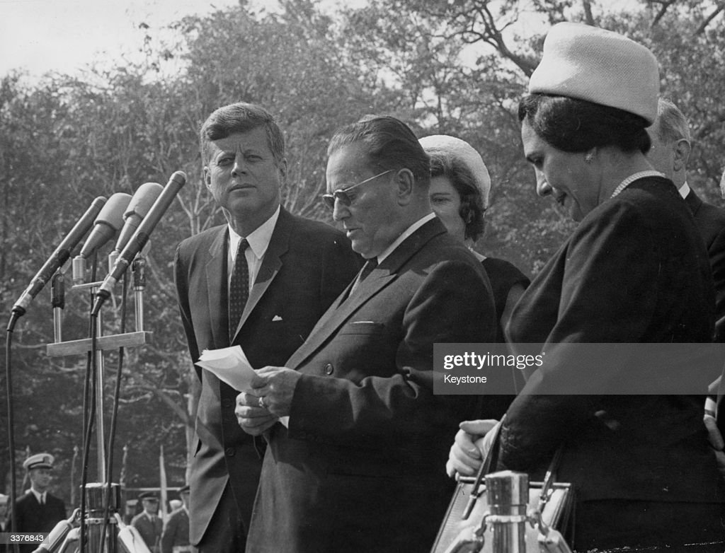 The 35th President of the United States of America, John F Kennedy (1917 - 1963) listens to President Josip Broz Tito of Yugoslavia (1892 - 1980) giving a speech on the occasion of his visit to the White House in Washington, October 21, 1963. Marshall Tito's third wife Jovanka is by her husband's side.