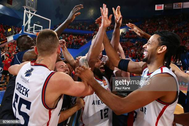 The 36ers celebrate after winning game two of the NBL Semi Final series between the Adelaide 36ers and the Perth Wildcats at Perth Arena on March 9...