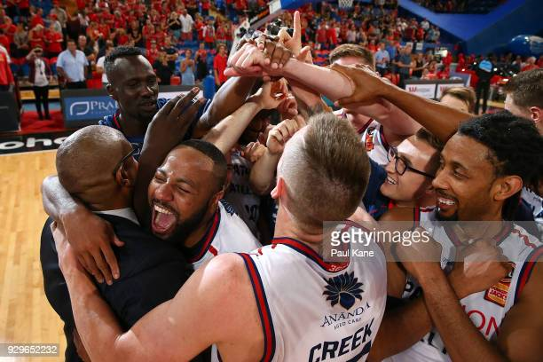 The 36ers celebrate with head coach Joey Wright after winning game two of the NBL Semi Final series between the Adelaide 36ers and the Perth Wildcats...