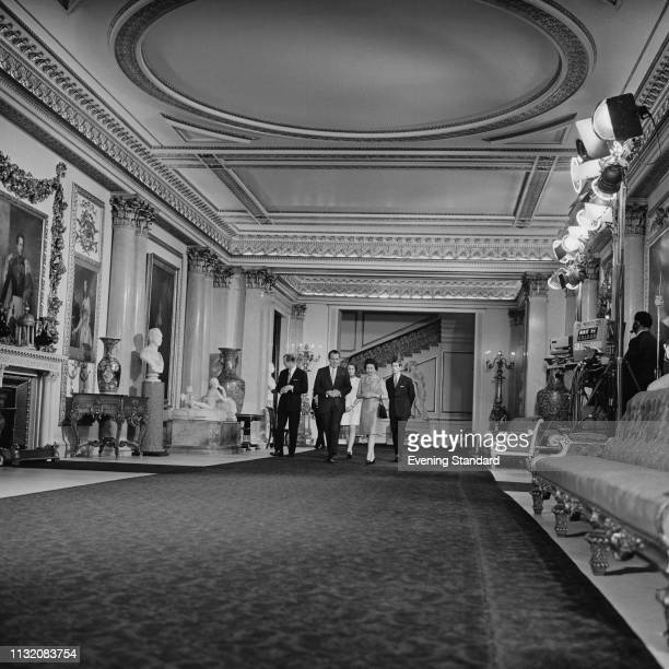 The 37th President of the United States Richard Nixon with Queen Elizabeth during a meeting at Buckingham Palace, with Prince Philip, Prince Charles,...