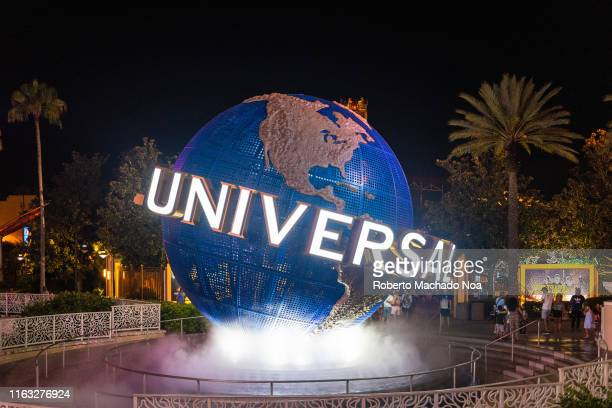 The 3d logo of Universal Studios is seen during the nighttime at the entrance of one of the themed parks in the area The place is a famous tourist...