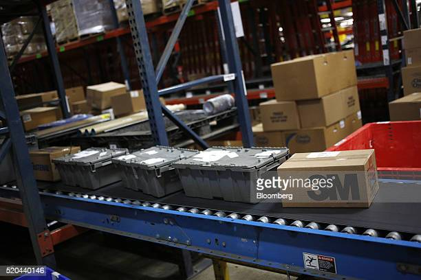 The 3M Co logo is seen on a box moving down a conveyor belt inside the Fastenal Co distribution center in Jessup Pennsylvania US on Thursday April 7...
