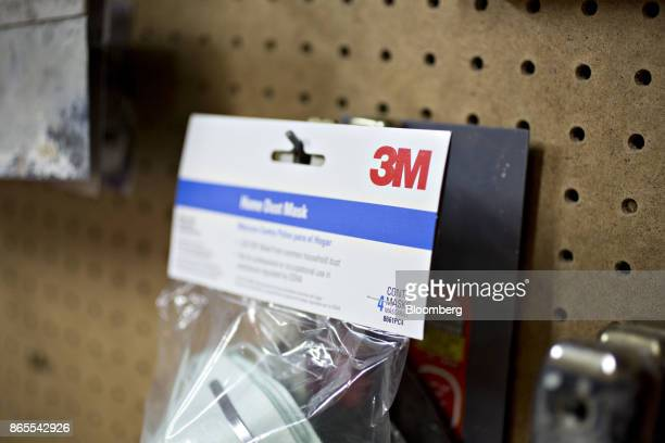 The 3M Co logo is seen on a package of dust masks in this arranged photograph taken in Tiskilwa Illinois US on Monday Oct 23 2017 3M is scheduled to...
