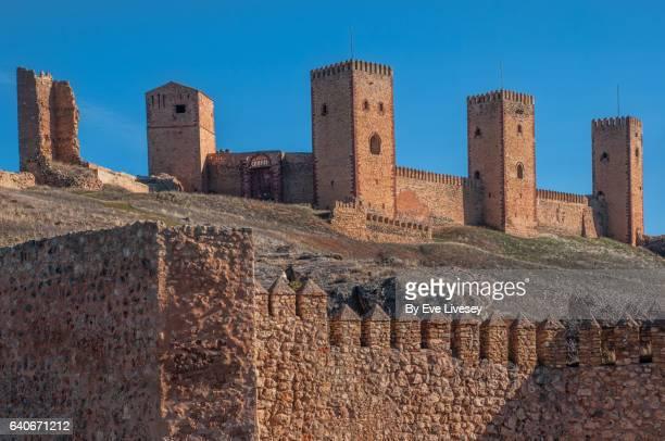 the 4 remaining towers and outside wall of molina de aragon castle - castilla la mancha fotografías e imágenes de stock