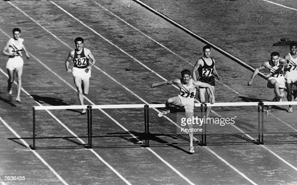 The 400 meters Hurdles Finals at the Olympic Games in Melbourne with Glenn Davis the American Champion in front of the field.