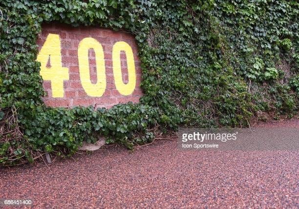 The 400foot marker in dead center field takes shelter under the ivy as a MLB game between the Chicago Cubs and Milwaukee Brewers was postponed due to...