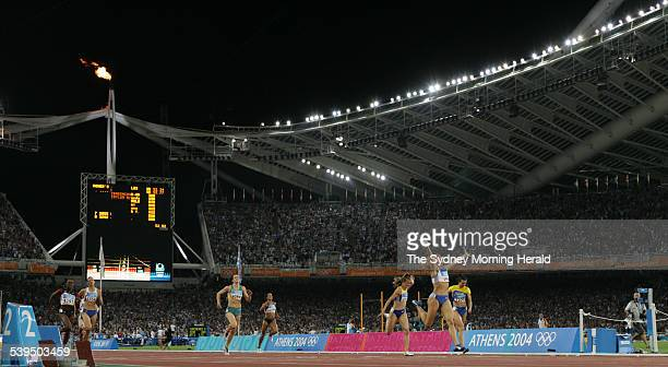 The 400m Hurdles event at the Athens Olympics on 25 August 2004 Greek athlete Fani Halkia wins the gold medal as Australian Jana Pittman finishes...