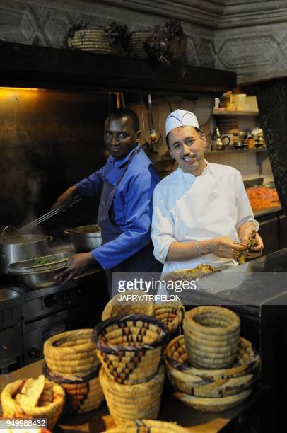 The 404 restaurant the chef preparing speciallities of North Africa in the kitchen located Rue des Gravilliers in Marais area 3 rd district in Paris...