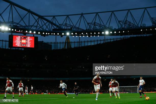 The 4-2 score is shown on the scoreboard late in the game during the English Premier League football match between Arsenal and Tottenham Hotspur at...