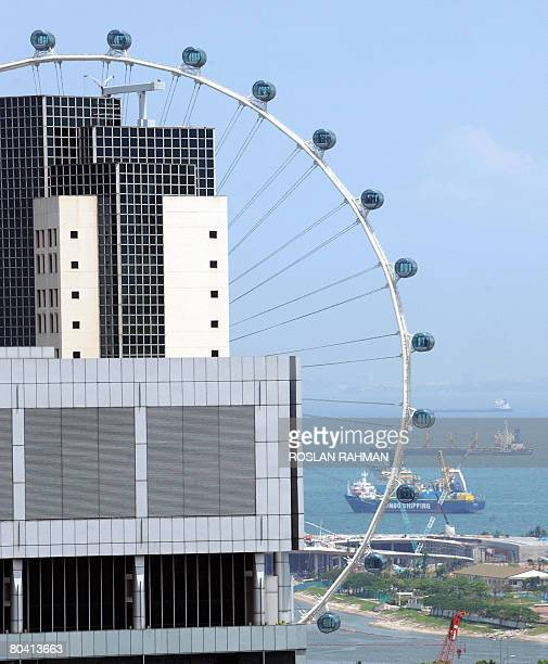 The 42storeyhigh wheel capsule with a 360degree view across the island and one of the tourist attractions is seen next to a higrise building in...
