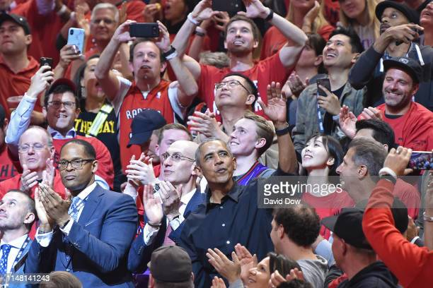 The 44th President of the United States Barack Obama waves to the crowd during Game Two of the NBA Finals between the Golden State Warriors and the...
