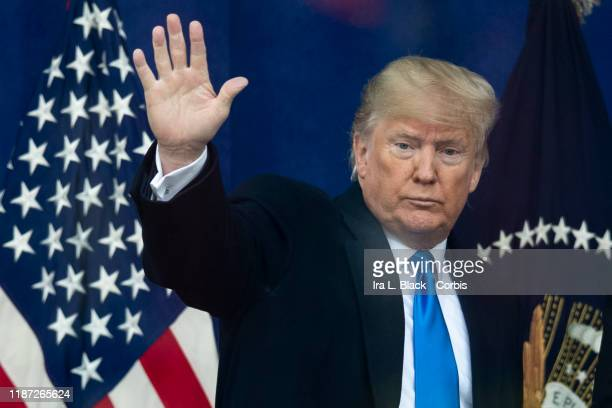 The 45th President Donald J Trump waves goodbye to the crowd with the American Flag behind him after his opening ceremony of the New York City 100th...