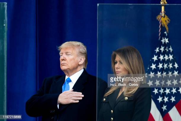 The 45th President Donald J Trump with his had on his heart and the First Lady Melania Trump with her arms at her side after he addressed the crowd...