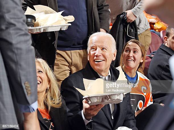 The 47th Vice President of the United States Joe Biden and his wife Jill Biden receive ice cream from the staff of the Wells Fargo Center during a...