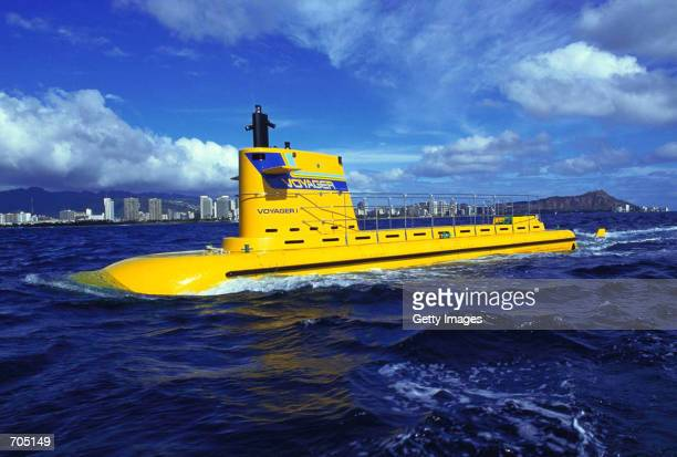 The 48passenger Voyager I submarine is shown in this undated photo at sea off of Honolulu Harbor HI Two 72feet 48 passenger yellow submarines are...