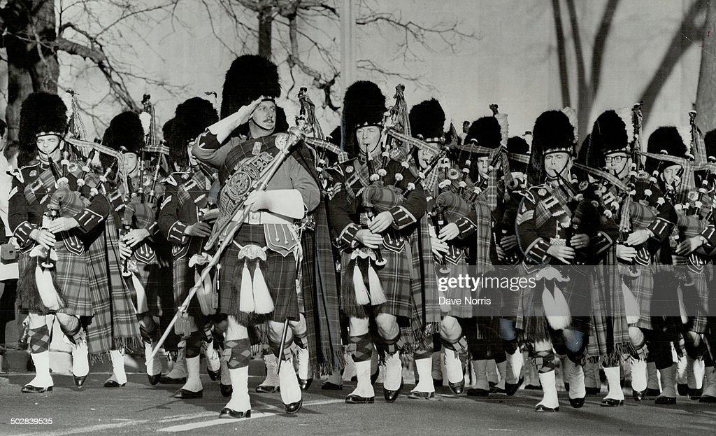 The 48th honor remembrance day. Bagpipes skirling; sporrans swinging and kills swaying; men of 48th  : News Photo