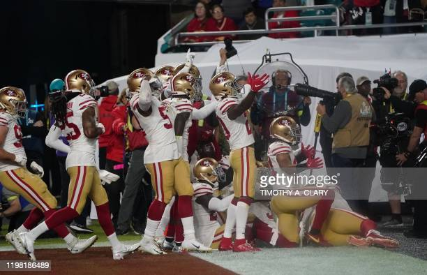 The 49ers team celebrates after intercepting a pass by Quarterback for the Kansas City Chiefs Patrick Mahomes during Super Bowl LIV between the...