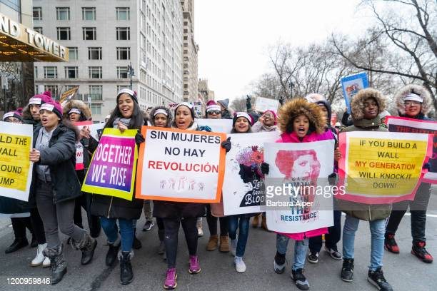 """The 4th Annual Women's March gathered at Columbus Circle in NYC, January 18, 2020. This group were all wearing headbands saying """"This Is What..."""