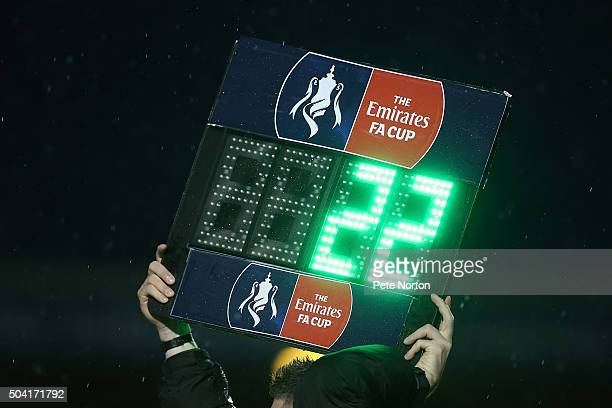 The 4th Official holds the substitute board aloft during The Emirates FA Cup Third Round match between Northampton Town and Milton Keynes Dons at...