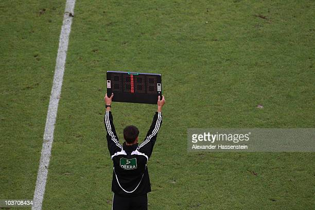 The 4th referee shows the extra time during the Bundesliga match between VfB Stuttgart and Borussia Dortmund at MercedesBenz Arena on August 29 2010...