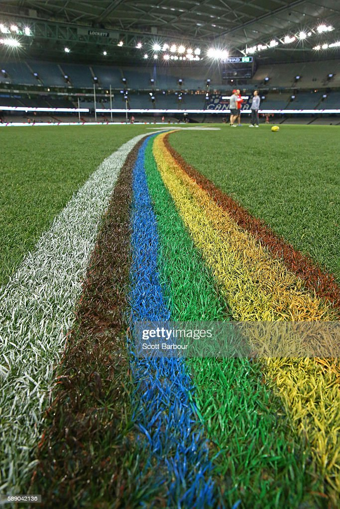 The 50 metre arcs are painted rainbow-coloured during the round 21 AFL match between the St Kilda Saints and the Sydney Swans at Etihad Stadium on August 13, 2016 in Melbourne, Australia. St Kilda and the Sydney Swans played in the inaugural AFL Pride Game, believed to be a world-first in professional sport celebrating diversity and inclusion of all people in sport.