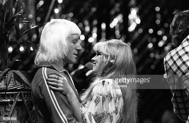 The 500th edition of the BBC's popular chart show 'Top Of The Pops' presented by disc jockey Jimmy Savile with the assistance of pop singer Lynsey de...