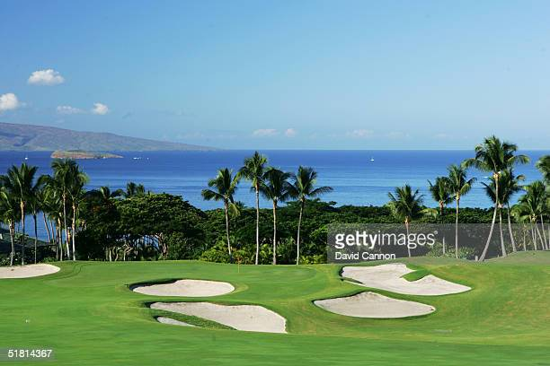 The 553 yard par 5 18th hole on the Wailea Golf Club Emerald Course in Wailea on the island of Maui Hawaii USA