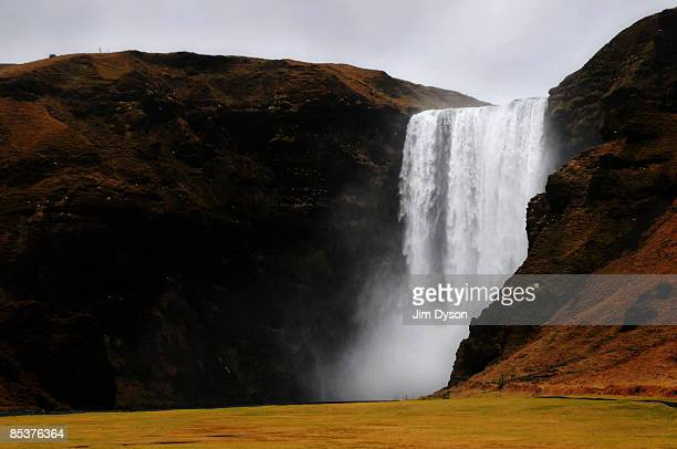 The 60 metre high Skogafoss waterfall cascades down a mountain on February 20, 2009 in the south of Iceland. A country of glacial and volcanic...