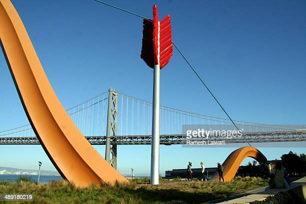 The 60-foot-high painted fiberglass and stainless-steel sculpture represents a bow and arrow -- traditional attributes of the imp of love -- shooting...