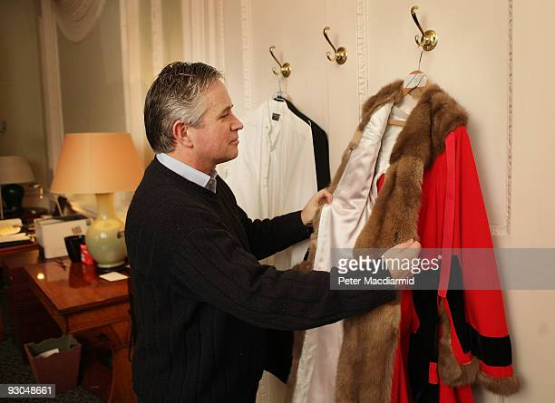 The 682nd Lord Mayor of London Nick Anstee checks his ceremonial robe before the start of the Lord Mayor's Show on November 14 2009 in The Mansion...