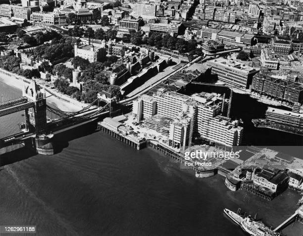 The £7 million Tower Hotel under construction on the River Thames in London with Tower Bridge on the left the Tower of London at top left and St...