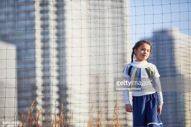 the 7 years old girl playing in the town - 6 7 years stock pictures, royalty-free photos & images