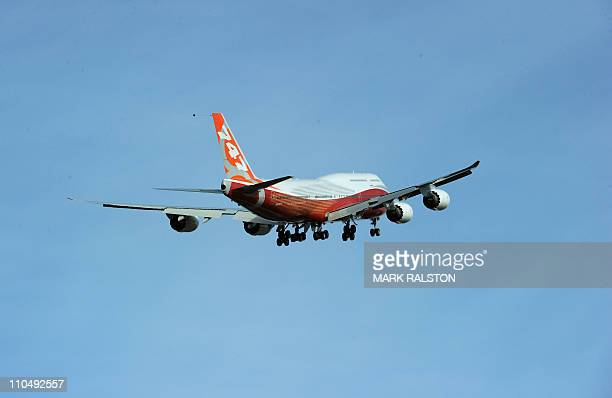 The 747-8 Intercontinental, Boeing's largest-ever passenger airplane, takes off for the first time from Paine Field in Everett, Washington state on...