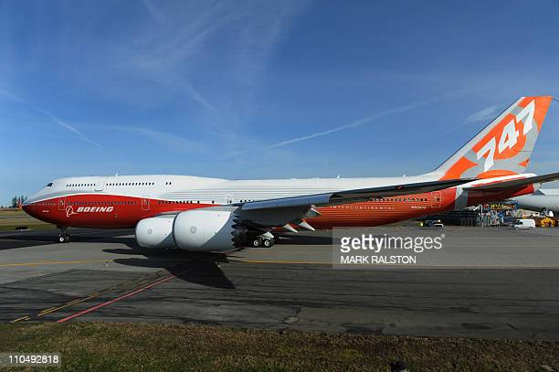 The 747-8 Intercontinental, Boeing's largest-ever passenger airplane, prepares to take off for the first time from Paine Field in Everett, Washington...