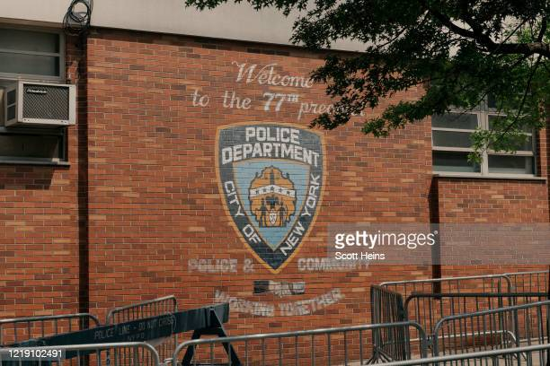 The 77th Precinct of the NYPD remains barricaded during a press conference demanding justice for Kenneth Bacote, who was permanently blinded in one...