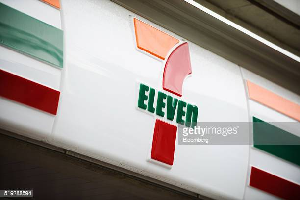 The 7Eleven logo is displayed at a convenience store operated by Seven i Holdings Co in Kawasaki City Kanagawa Prefecture Japan on Tuesday April 5...