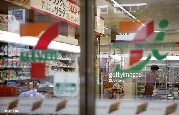 The 7Eleven logo is displayed on the door of a convenience store operated by Seven i Holdings Co in Tokyo Japan on Thursday Oct 6 2016 The Japanese...