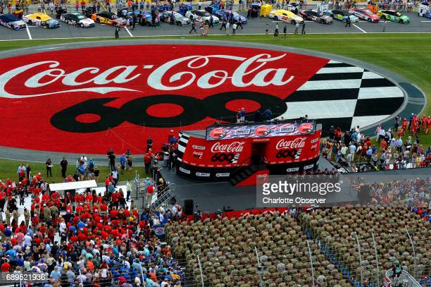The 82nd Airborne AllAmerican Chorus performs as soldiers stand at attention during prerace activities for the CocaCola 600 at Charlotte Motor...