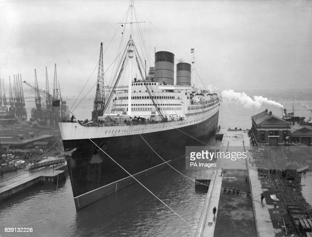 The 85000 ton Queen Elizabeth at Southampton The enormous vessel is being refitted from it's wartime role as a troop ship to it's peace time role as...